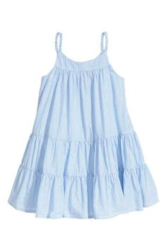 Evie Flared, tiered dress in an airy cotton weave with narrow, braided shoulder straps and an opening with a button at the back of the neck. Girls Blue Dress, Little Girl Dresses, Girls Dresses, Toddler Outfits, Kids Outfits, Toddler Dress Patterns, Sewing Clothes Women, Toddler Girl Style, Fashion Kids