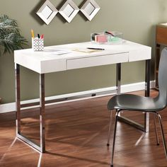 The ultra-stylish Vivica desk from Upton Home features a textured reptile pattern on a cream tabletop with a metal frame. This desk is ideal for small spaces and can easily be tucked into the corner of a guest room.