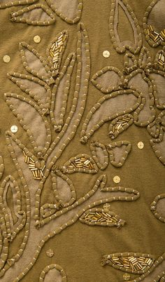 Florence Dress (detail) is hand embroidered with gold beading. Alabama Chanin