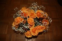 orange roses with baby's breath accent