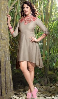 Blend into the cream of the society by dressing into this gray shade embroidered linen tunic. The enticing floral patch and resham work a vital attribute of this kurti.  #SexyClassicalTunicKurtis