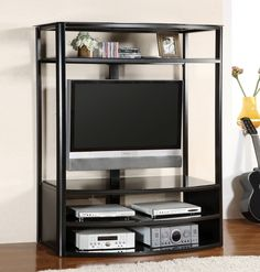 "FARON IThis entertainment center is perfect for a small space and has an attractive contemporary silhouette. Featuring multiple open shelving for components, and additional shelving above the TV for decorator items. A sturdy mount bracket included.54"" TV CONSOLE [CM5134-TV]54 1/8""W X 19 7/8""D X 67 3/8""HBlack Tempered Glass TopMount Bracket IncludedFits up to 48"" TVMetal ConstructionBlack Finish"