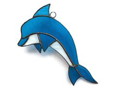 Are dolphins fish or animals? Who cares! They are funny, kind-hearted and whimsical, and thats the main idea. Here is stained glass dolphin