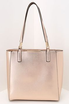 Start your day off on the right foot with a plethora of compliments on your Morning Stroll Rose Gold Tote! Metallic rose gold tote with black piping and gold hardware. Metallic Handbags, Gold Handbags, Purses And Handbags, Ladies Handbags, Cheap Purses, Cute Purses, Or Rose, Rose Gold, Gold Purses