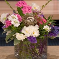 Add a nest and quail egg to your designs for a perfect spring centerpiece.
