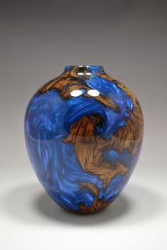 Live oak filled with resin and then turned. Not quite like most turned stuff, but pretty nonetheless.