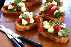 Serve these classic bruschetta topped with pesto, semi-dried tomatoes and cherry bocconcini.