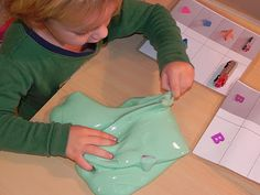 This is homemade silly putty (not as firm), but for a little toddler, its a great activity for strengthening the hands and fingers.  It promotes dexterity, grip strength, and overall motor skills (all important things for writing).