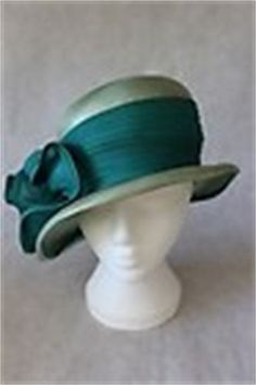 Mitzi Lorenz green straw cloche :  We have a large collection of hats by the renown milliner Mitzi Lorenz including this stunning green 1940's cloche. Buy this hat for £40.00