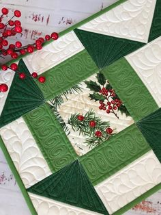 Are you ready to dec the halls with boughs of holly? This quilted table runner will add to your homes holiday decor. It would look great on an entry table, dining table, coffee table, buffet or sofa table. The colors, the quilting, the design all work together to make a fantastic holiday runner. Quilted Table Runners Christmas, Patchwork Table Runner, Christmas Runner, Table Runner And Placemats, Christmas Holidays, Quilted Table Runner Patterns, Xmas Table Runners, Christmas Ideas, Purple Christmas