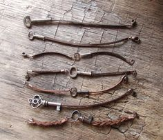 A charming rustic skeleton key bracelet on a chestnut brown leather cord. I created these bracelets out of genuine loose keys that came from a local