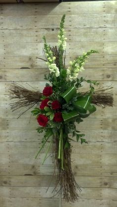 Grapevine Cross with a contemporary floral design of Snapdragons, Roses, and assorted foliage