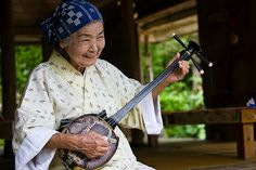 Woman with Okinawan Sanshin. The okinawans live long lives and seem to enjoy many pursuits into old age.  They are 'genki' ( healthy)