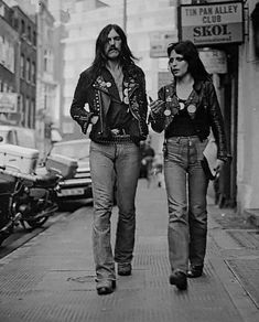 Just two bass players strolling down Denmark Street in London ca. Lemmy Kilmister from Motorhead & Gaye Advert from The Adverts.