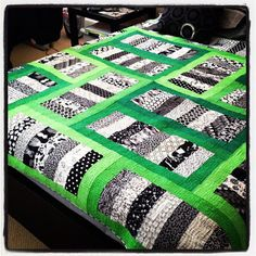 Framed coins - black & white fabrics + 4 Kona green solids - Skip the borders by Jaybird Quilts