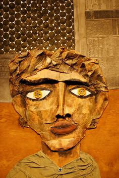 """""""Juanito Laguna,"""" by Antonio Berni (1905-1981).  An oil, collage and mixed media on wooden board, 48 by 40 1/2"""" 1977. Juanito Laguna, is a fictional """"street urchin"""". Juanito's face is made of corrugated paper and the background includes papers pressed from lead molds for newspaper printing. sold for $100,000."""