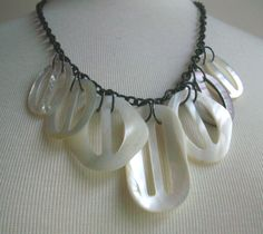 Repurposed Necklace Mother of Pearl Belt Buckles. $40.00, via Etsy.