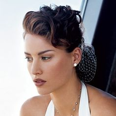 Love this use of netting, love her hair for a bridal look.