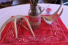 Centerpieces For Western Theme Party | The rustic centerpieces featured tall sticks in mason jars and twine ...