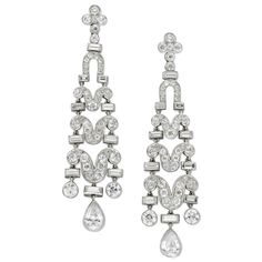 1920s Art Deco Diamond Earrings | From a unique collection of vintage chandelier earrings at https://www.1stdibs.com/jewelry/earrings/chandelier-earrings/