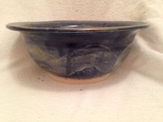 Wheel thrown stoneware cobalt blue and shino bowl.  Glazes are food, microwave and dishwasher safe.
