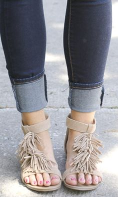 Tan suede fringe sandals in a T-strap shape with a back zipper