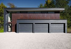 : Astonishing Clearview Residence Outside View Detached Garage And Shed With Triple Doors Lush Bush Behind It