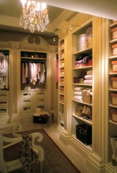 Love the shelving and column look.  Walk in closet dressing room, fabulous trim off white french provincial