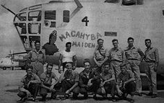 """PARNAMIRIM FIELD - Above the 3rd standing from right is Lt. William Ford, commander of the Consolidated Vultee PB4Y-1107-B-4, """"Macahyba Maiden"""". This officer sank the U-164 submarine in 6:01:43, with PBY-5A Catalina 83-P-2 VP-83 squadron and the PB4Y 107-B-4 participated in the U-848 sinking in 5:11:43."""