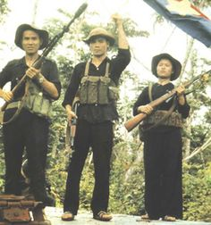 Vietnamese Guerrillas on patrol. I think the guerrillas were on duty. Were there others on duty at the same time?