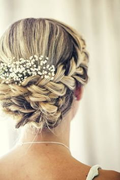 Beautiful Wedding Updo with a braid and baby's breath
