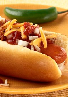 Salsa-BBQ Hot Dogs -- BBQ sauce and salsa team up to make the flavorful sauce for these zesty hot dog sandwiches. Bonus: This recipe is dinner table-ready in just 20 minutes time.