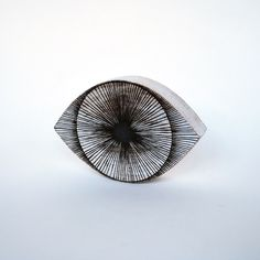 """A man of science once told me that when someone draws or paints just one eye, it could be a sign of schizophrenia.  Subtle lines, slight irregularities and faceted edges allow Michele Quan's stoneware to inspire a dialogue about the hand and work of an artist and the work of nature.  Less Info  Stoneware  Approx. 8 1/4"""" L x 1 1/2"""" W x 5 1/2"""" H"""