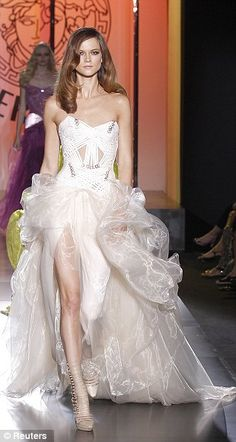 Haute couture: Versace's long evening gowns in pastel shades featured corseted waists and split skirts ~ Couture Fashion Week in Paris ~ July 2012