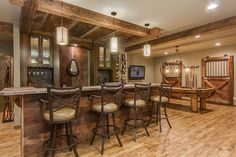 This Basement Combines Rustic And Luxury Materials To Create An Eclectic  And Rich Looking Space.