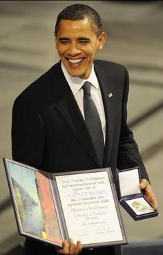 Barack Obama Receiving Nobel Prize ~  It's not about perfection, but movement in the right direction.
