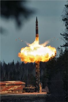 Ballistic Missile Launching In Plesetsk, Russia  The RT-2UTTKh 'Topol-M' is one of the most recent intercontinental ballistic missiles of Russia. Specifications: Weight: 47200 kg (104,000 lb); Length: 22.7 m (74.47 ft); Diameter: 1.9 m (6 ft 3 in); Warhead: Single 800 kt warhead; Engine: Three-stage solid propellant; Range: 11,000 km (6,800 mi); Speed: 10,800 mph (17,400 km/h); System: Inertial with GLONASS; Accuracy: 200 m CEP.