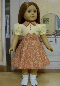 coral pink and pale yellow frock floral. Coral pink floral skirting with stitching at center. 3 coral pink buttons on bodice. short gathered sleeves with cuffs. American Girl Doll Molly, American Girl Dress, American Doll Clothes, Sewing Doll Clothes, Girl Doll Clothes, Doll Clothes Patterns, Doll Patterns, Girl Dolls, Dresses Kids Girl