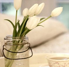Beautiful use of foreground, white tulips and a cup of tea, a great way to wake up. Selling dreams