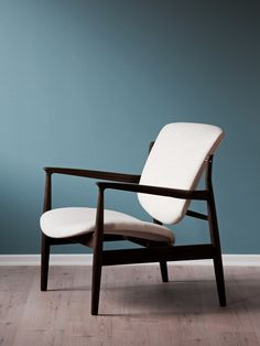 Teal coloured wall and the beautiful French chair by Danish furniture  designer Finn Juhl  TheReading Chair   In 1953 the architect Finn Juhl designed a small  . Finn Juhl Chair 108. Home Design Ideas