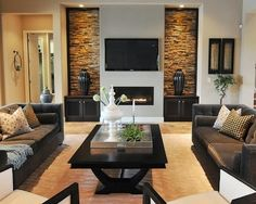 Principles of design: Balance: This is very symmetrical with the way the couches are set-up in relation to the t.v., fireplace & walls.  Rhythm: The brick part (at least, I think it's brick!) of the wall adds a nice rhythm since it's got the pattern throughout it, but yet isn't covering the whole wall. I feel like that would've been overkill!!