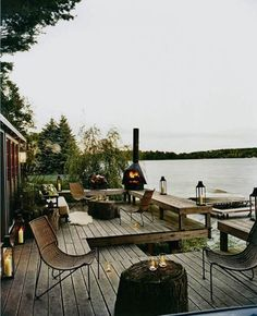 Beautiful lake house - great stump coffee tables and lanterns.  Nice bench seating built into the edge of the deck - would work well below our pear tree.