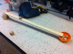 Ramp building challenge: make a ramp that can deliver a ping pong ball to a bucket. Could do other such challenges with blocks and other materials as well.