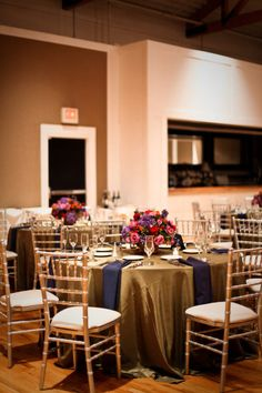 gold tables with navy napkins