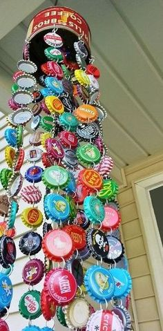 DIY project du jour: Make a wind chime from bottle caps.  Materials: An old tin/can/colander for the top, bottle caps, wire (or jump rings), a hammer, an awl, and pliers.   (via Bottle Cap Chime, from Kelli Nina Perkins's EphemeralAlchemy blog)