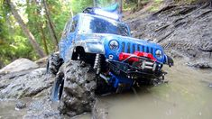 RC ADVENTURES - Sloppy Mud - Swamp Bogging in a 4x4 Jeep Wrangler Rubico...