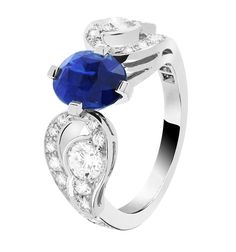 Van Cleef & Arpels Aladdin Solitaire in platinum, set with round diamonds and a 2.08ct oval-cut sapphire.