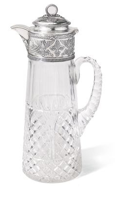 A Fabergé silver-mounted cut glass decanter, Moscow, 1899-1908, the tapering body cut with diamonds and fluting, the collar mount with a frieze of swans supporting laurel festoons within Greek key and bound laurel borders, the hinged lid with laurel wreath finial, gilt interior.