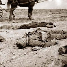 1865 Petersburg, Virginia - a Confederate and Union soldier laying dead, side by side.