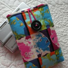 Camera Sleeve -- Fun Faces -- Fits Many Other Small Gadgets. $14.00, via Etsy.